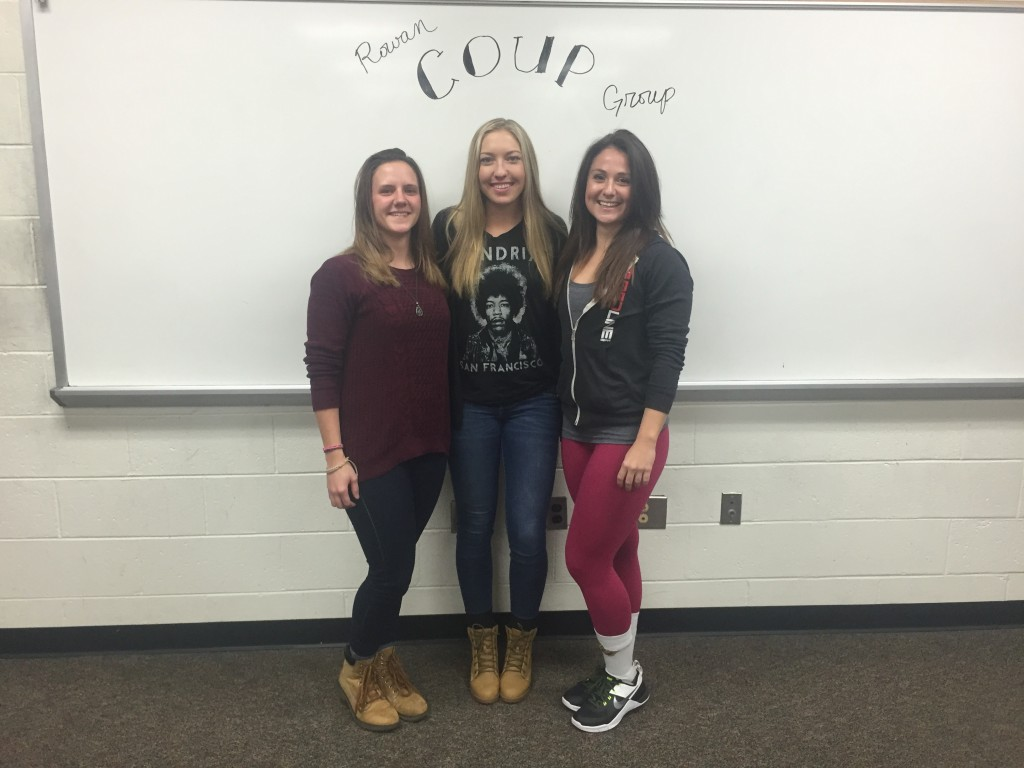 From left: COUP President Samantha Della Fave, junior accounting major Erica Fredericksdorf and junior health promotion and fitness management major Catherine Luick at the Tuesday, Dec. 8 COUP meeting. -Leon Purvis for The Whit