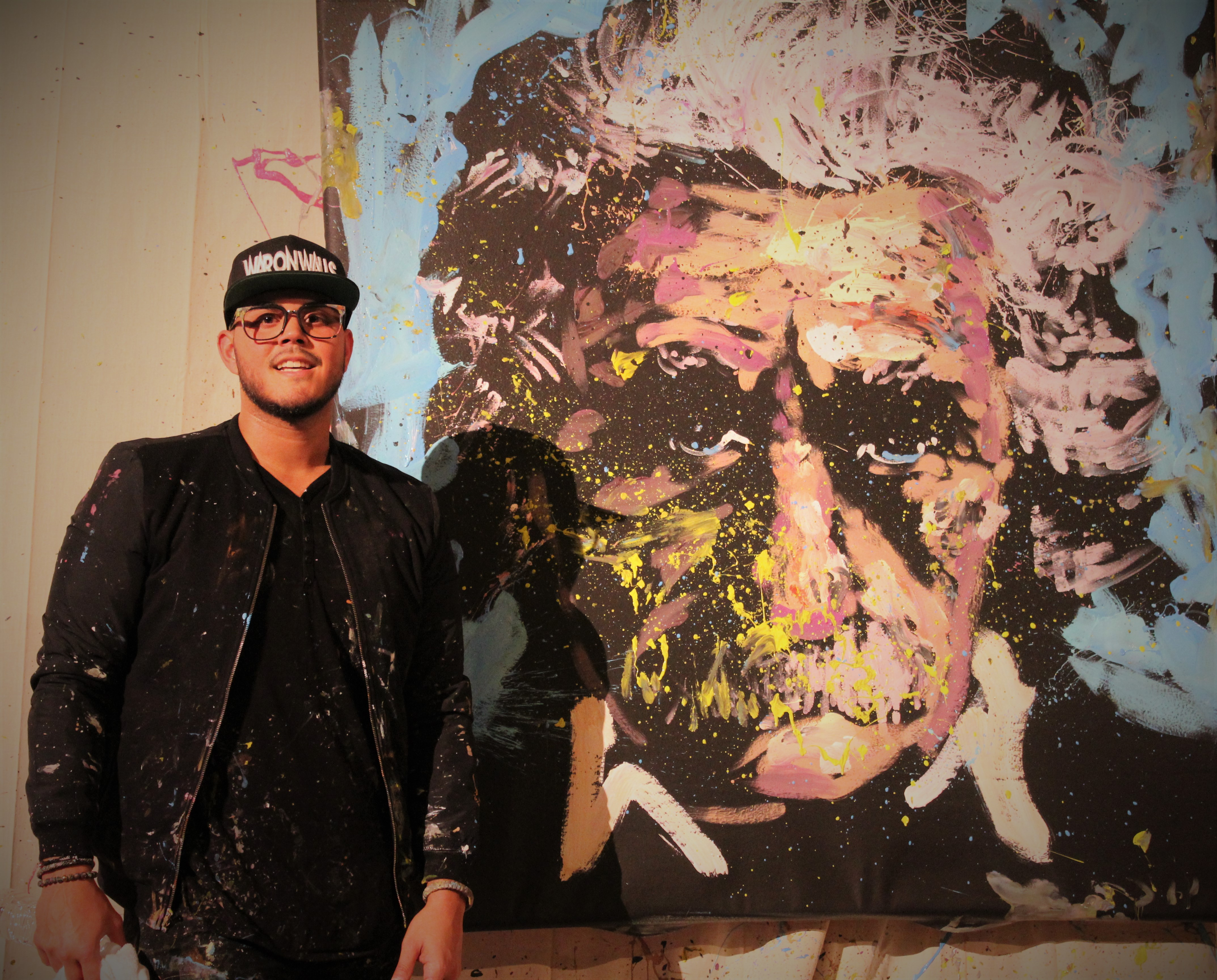 David Garibaldi standing in front of a painting
