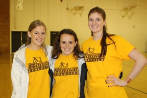 From left: Sarah Rosenberg, Maddie Williscroft and Erin Keegan pose together during National Girls and Women in Sports Day. All three play on a Rowan University sports team. -Jessica Kovalick for The Whit.