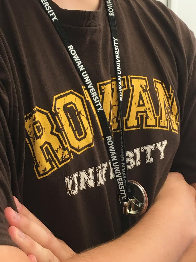 A student dons Rowan gear, including a Rowan lanyard. Photo courtesy of Nicole Mingo