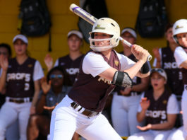 Rowan softball senior captain Morgan Smith takes an at-bat earlier this year. Smith is 4-8 with five walks in just four games this season. Photo courtesy of Sports Information